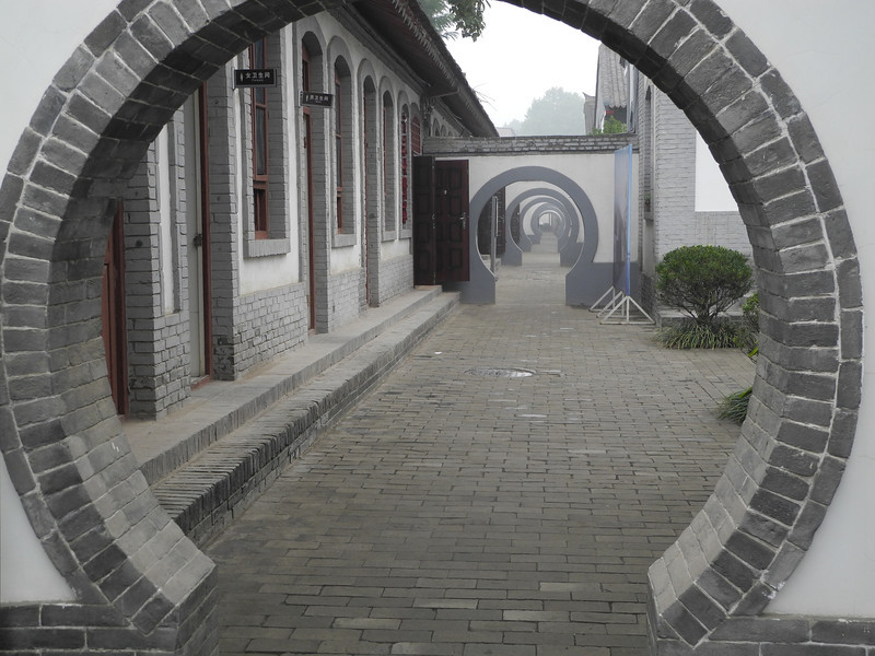 Very traditional Moon Gates lead to many little plazas with rooms off it