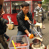 Behind the Drum Tower we found a large street market with this pomegranate juicer the first vendor