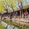 During lunchtime this narrow streets was crowded with people during a day trip from Shanghai.