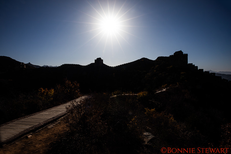 """Sunrise"" at the Jingshanling section of the Great Wall of China.   In fact this was much later than sunrise - thing is the sun had to travel a distance to ""clear"" the mountain and wall.  Nice effect."