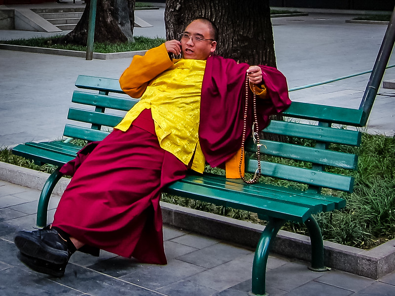 Buddhist Monk Speaking on Mobile Phone at Lama Temple, Beijing, China