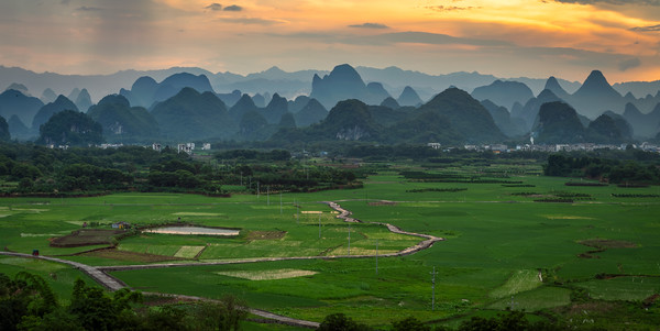 Sunset panorama of the spectacular valleys and karst mountains of Guilin, China.