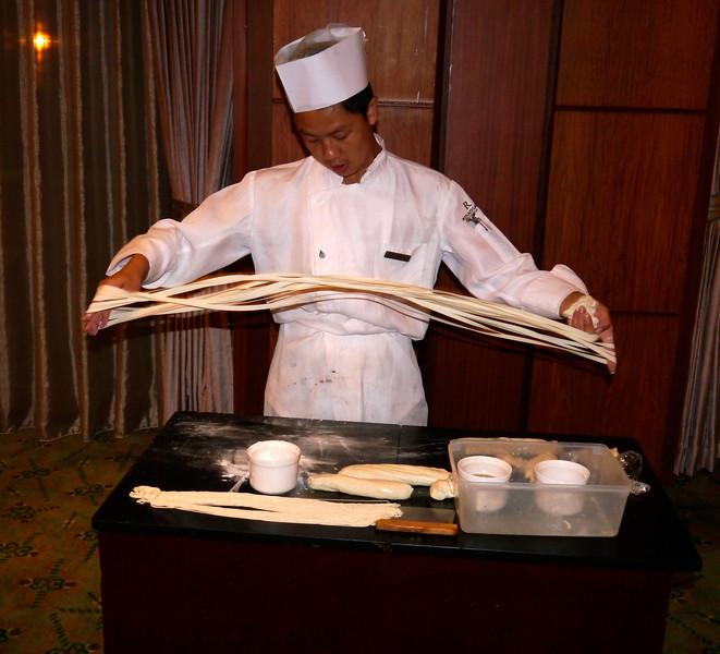 Beijing. We get a noodle making demonstration at dinner.
