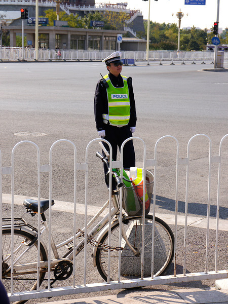 Beijing. Tiananmen Square-The Gate of Heavenly Peace-The Forbidden City.  Traffic cop.