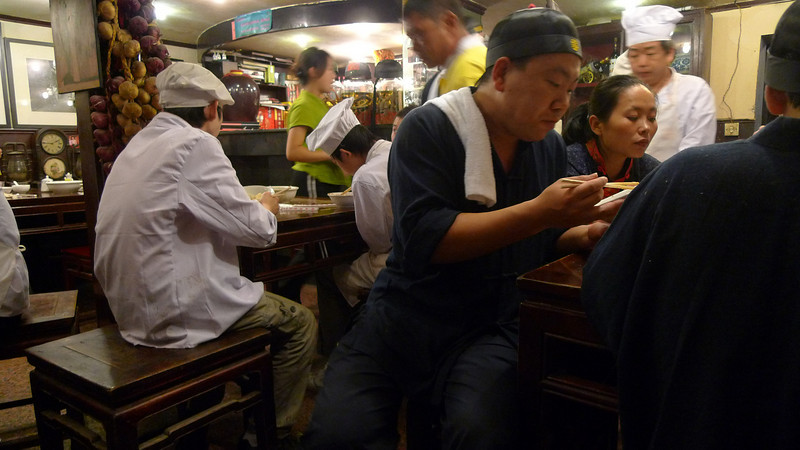 Closing time at a neighborhood restaurant in Beijing and it is time for the staff to eat!