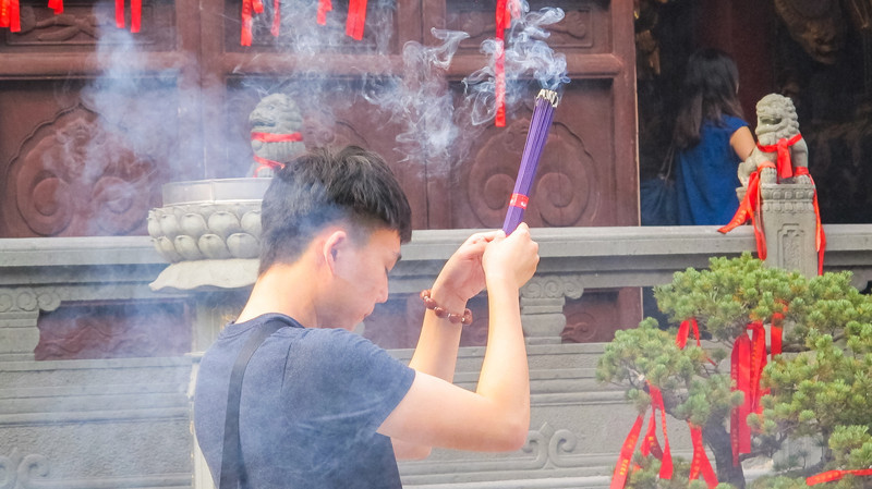 Offering prayers at the Jade Buddha temple
