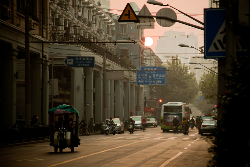 The afternoon sun peers through the haze in Shanghai.