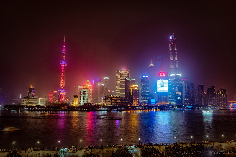 Shanghai skyline view from the Bund waterfront, on a hazy evening.