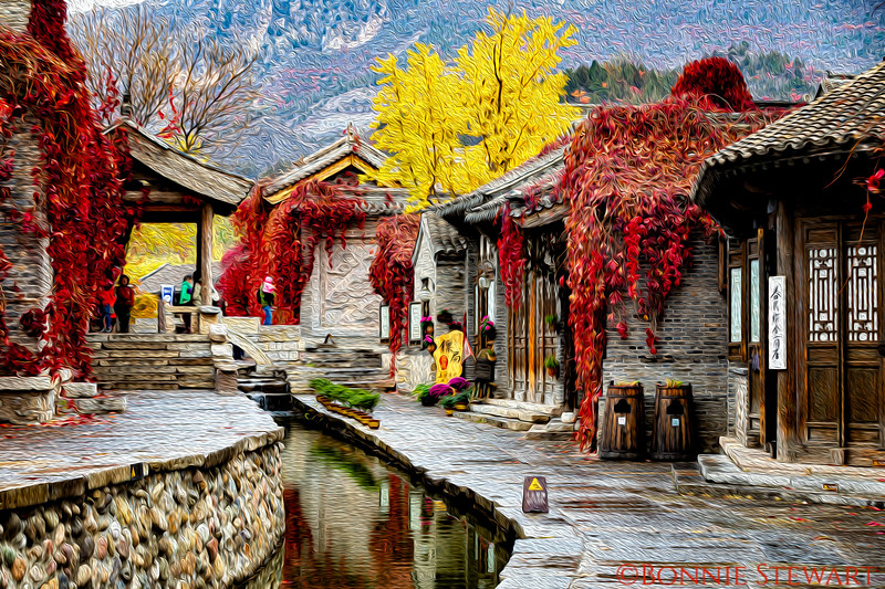 Gubei Water Town - recreated in historic fashion.  The photo has an oil painting filter added that seems to convey the extraordinary charm of this town.