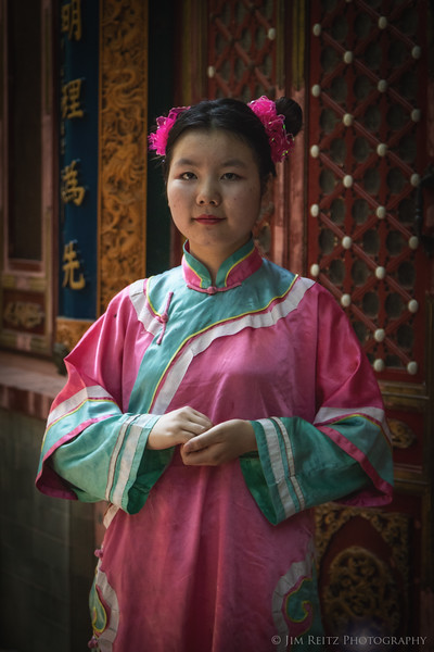Colorful native dress for staff at a Beijing restuarant.