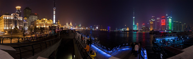 An 11-photo panorama of The Bund in Shanghai.  The west bank is full of majestic old buildings from Shanghai's early trading days, while the modern financial centre is now located on the east bank.