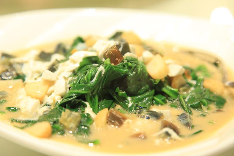Spinach stir fried with garlic, tofu and century egg - Qingdao