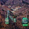 Cable cars at the Jingshanling Section of the  Great Wall of China with the village for visitors below.