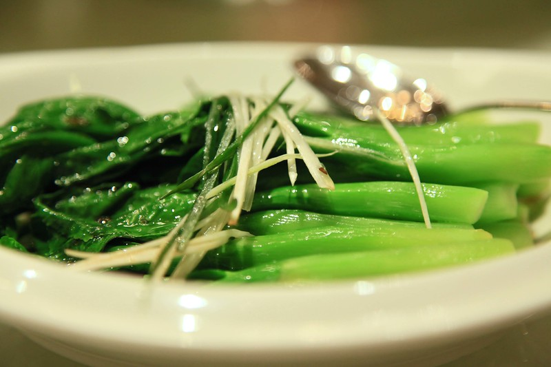Boiled green Chinese broccoli topped with ginger slices - Qingdao