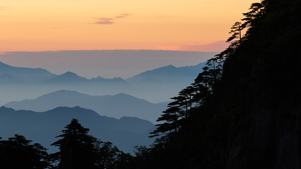 Layers upon layers. Sunrise in Huangshan (Yellow Mountain), China.