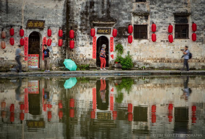 """Reflections in the """"Moon Pond"""" at the center of the village of Hongcun, China - where some scenes from the movie """"Crouching Tiger, Hidden Dragon"""" were filmed."""