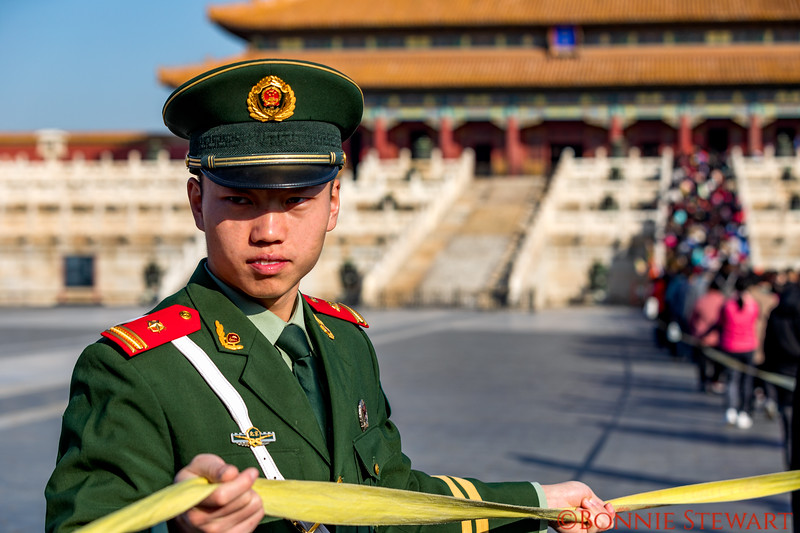 Guard in the Forbidden City directing visitors to one stair way in order to make room for guest visitors of importance