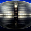 The National Center for Performing Arts, also know as the Egg.  The bottom is the reflection of the top!   Photo taken during the blue hour.