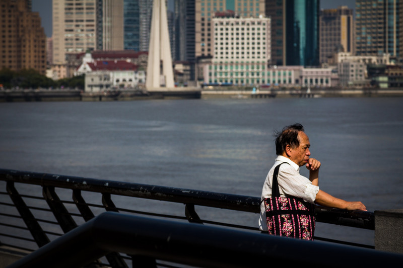Pondering with the impressive Shanghai skyline as a backdrop