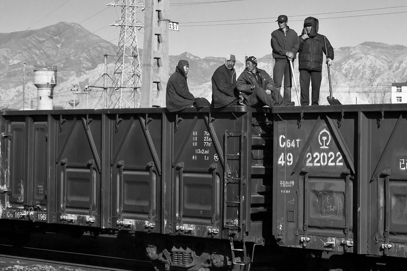 Rail workers in China seen from the Trans-Siberian railway, between Beijing and Ulaanbaatar.
