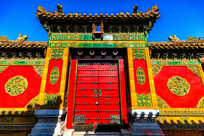 Spectacular doors in the Forbidden City with exquisite detail in the carvings.