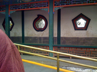 The wall enclosing the Empress' Court had wonderfully shaped openings to view the lake. The Empress had the double glass in the openings painted with flowers and birds to frame the lake view.