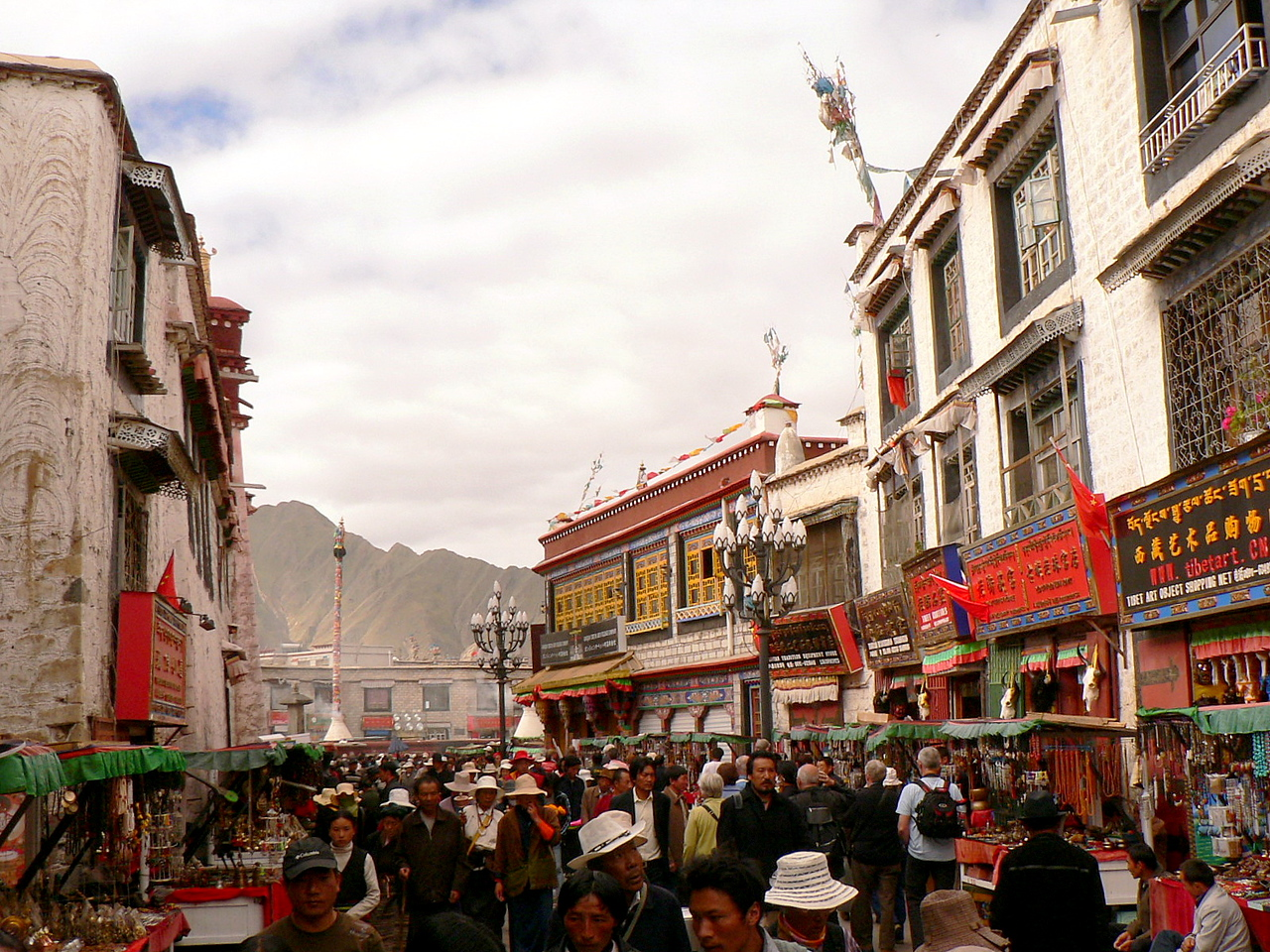 Pilgrims circling  and prostrating around the Jokhang Temple