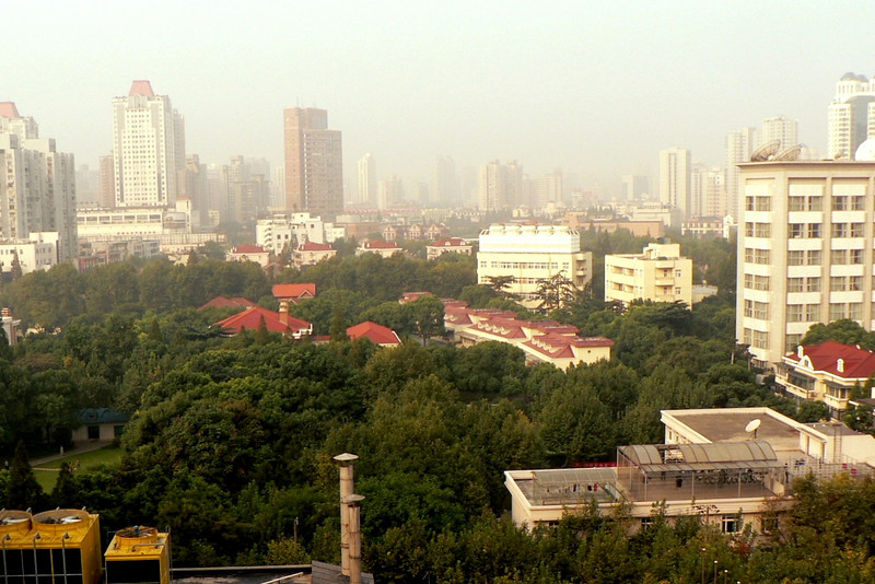 Shanghai...<br /> <br /> ...the view from our hotel, the Regal International East Asia Hotel.  Haze or smog...you decide.