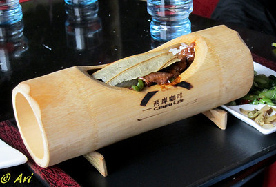 Beef and rice served inside a bamboo section.