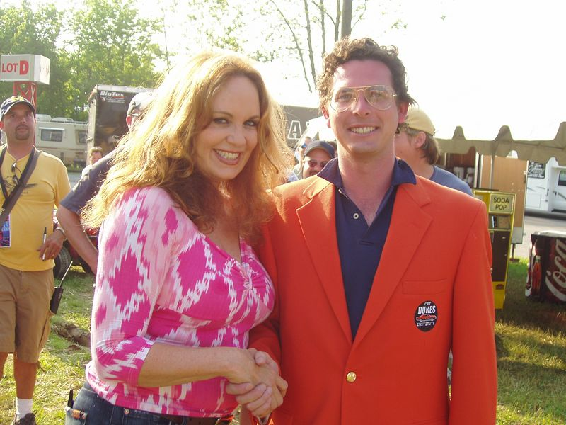 """Catherine """"Daisy"""" Bach congratulates Vice President, CMT Dukes of Hazzard Institute Christopher Nelson backstage at CMT DukesFest 2005 on Saturday, June 4, 2005 at the Bristol Motor Speedway and Dragway. Nelson's first official act as VP was presenting the Special Olympics of Arkansas with a $10,000 check from the CMT Dukes of Hazzard Institute. The Dukes of Hazzard airs 7 amd 11 pm ET/PT weeknights on CMT: Country Music Television. Photographer: Dan Smigrod"""