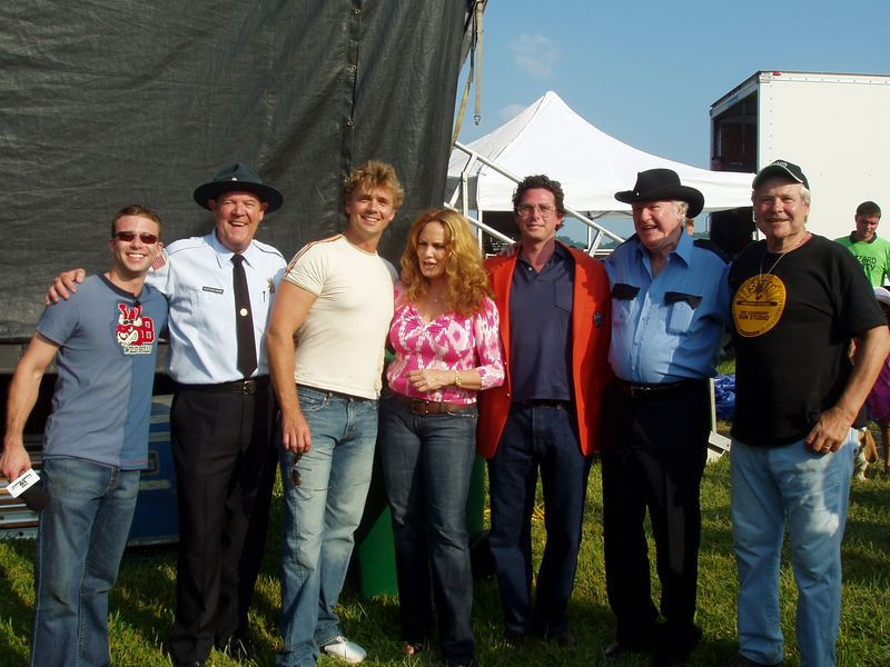 """Newly appointed Vice President, CMT Dukes of Hazzard Institute Christopher Nelson (center) backstage with CMT Top Twenty Host Lance Smith, Rick """"Deputy Cletus Hogg"""" Hurst, John """"Bo Duke"""" Schneider, Catherine """"Daisy"""" Bach, James """"Sheriff Rosco P. Coltrane"""" Best and Ben """"Cooter Davenport"""" Jones at CMT DukesFest 2005 on Saturday, June 4, 2005 at the Bristol Motor Speedway and Dragway. Nelson's first official act as VP was presenting the Special Olympics of Arkansas with a $10,000 check from the CMT Dukes of Hazzard Institute. The Dukes of Hazzar weeknights on CMT: Country Music Television.  Photographer: Dan Smigrod"""