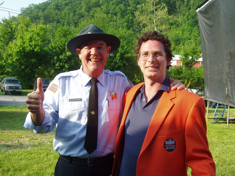 """Rick """"Deputy Cletus Hogg"""" Hurst gives the thumbs up to Vice President, CMT Dukes of Hazzard Institute Christopher Nelson backstage at CMT DukesFest 2005 on Saturday, June 4, 2005 at the Bristol Motor Speedway and Dragway. Nelson's first official act as VP was presenting the Special Olympics of Arkansas with a $10,000 check from the CMT Dukes of Hazzard Institute. The Dukes of Hazzard airs 7 amd 11 pm ET/PT weeknights on CMT: Country Music Television. Photographer: Dan Smigrod"""