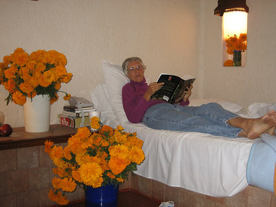 A lot of marigolds in a small hotel room!