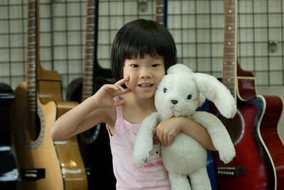 This music shop was looked after by two young girls, who liked the long lens on the camera and posed for photos.