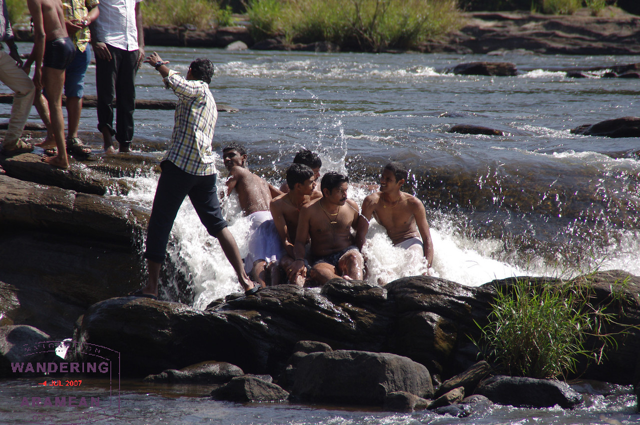 Playing in the water upstream from Athirappilly Falls