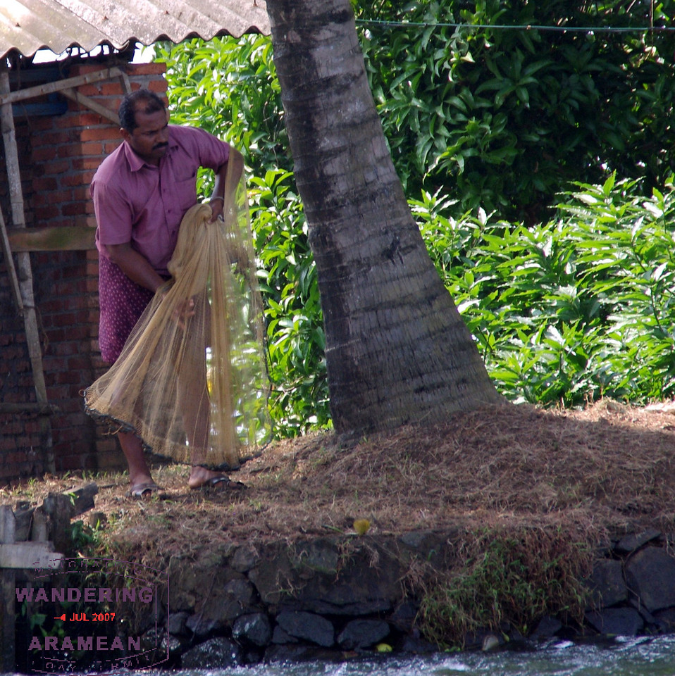 Getting ready to cast the net for fish in the backwaters