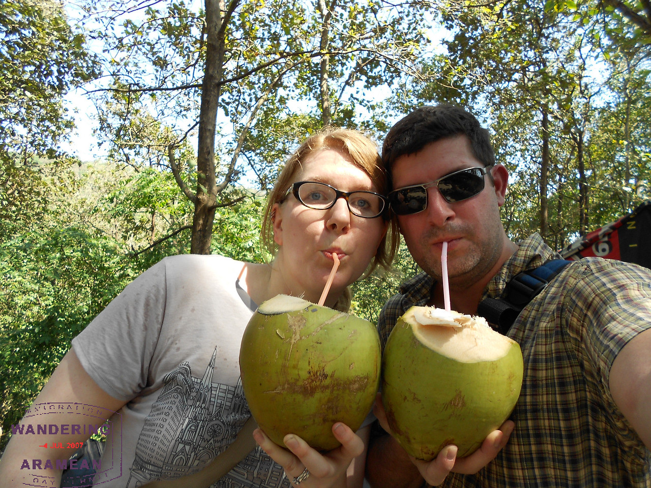 Enjoying some fresh coconut water after hiking the falls
