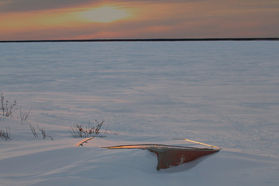Boat in Snowy Sunset