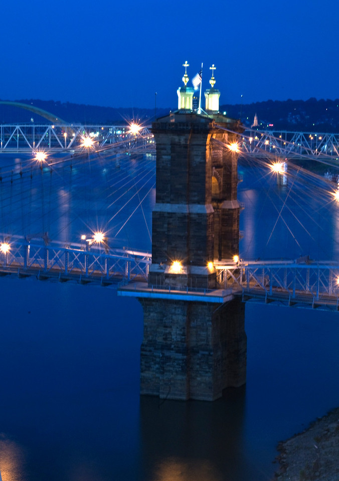 The Roebling Bridge between Covington , Kentucky and Cincinnati , Ohio opened to traffic on January 1, 1867.  Its central span of 1057 feet was the longest in the world.