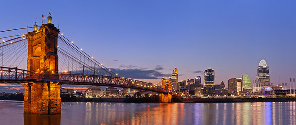 Cincinnati and John A. Roebling suspension bridge at twilight.