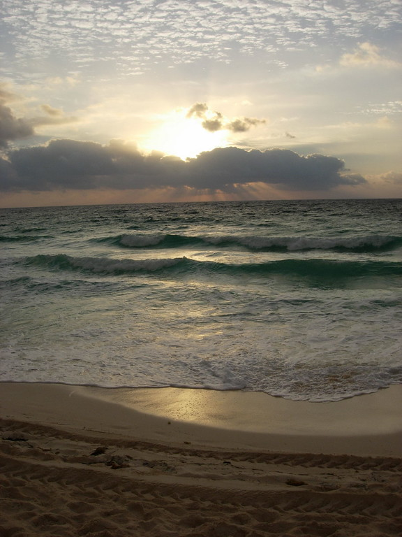 Sunrise over Cancun Mexico  ~<br /> Because I was vacationing by myself I didn't partake in a lot of late night partying so I was up pretty early every morning.  This was actually my favorite time of the day when I could sit on the beach by myself and watch the sunrise and reflect on all the reasons I should thank God for all that I have been given.  I truly feel that I have been very blessed.