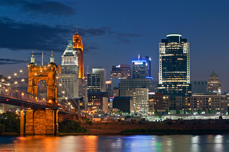 Cincinnati and John A. Roebling suspension bridge at twilight.