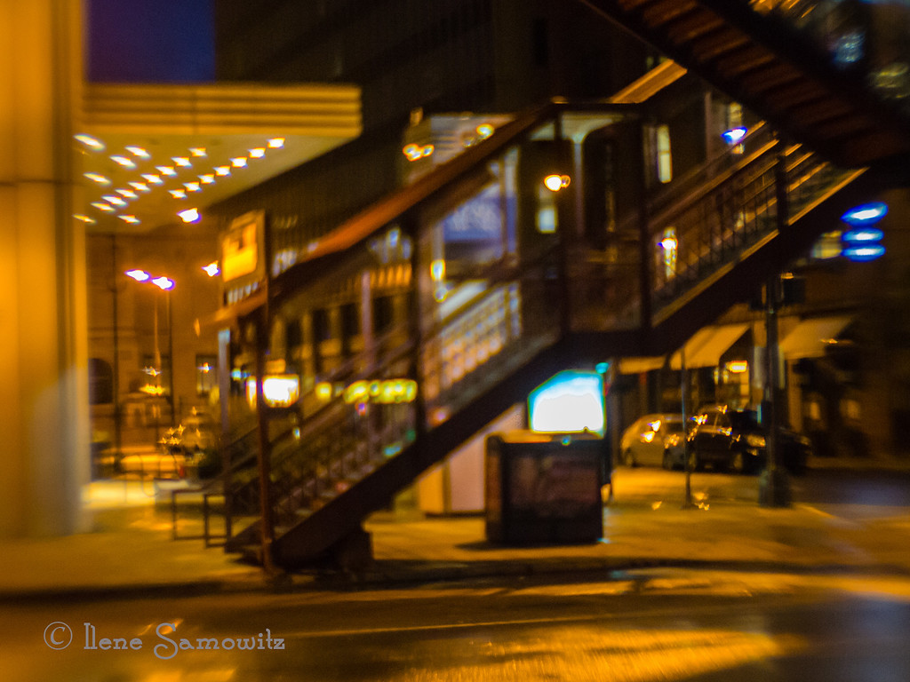 11-28-13 Nighttime Under the El<br /> Chicago,IL<br /> <br /> Shot with a Lensbaby Plastic Optic<br /> <br /> Thanks for all the support for my Chicago images. I had limited Internet so I did not get to comment as much as I wanted to. Happy Thanksgiving  and Happy Thanksgivukkah to all who celebrate either holiday.