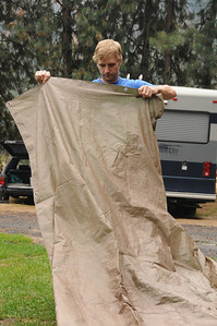 Dan spreads out the tarp which will serve as his base.