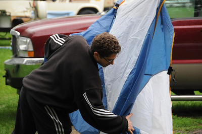 Jay and Jane pack up their flooded tent (inadequate rain fly) as they prepare to move into our trailer.