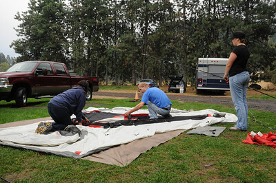 Dan, Barb, and Jessie set up their mansion tent.
