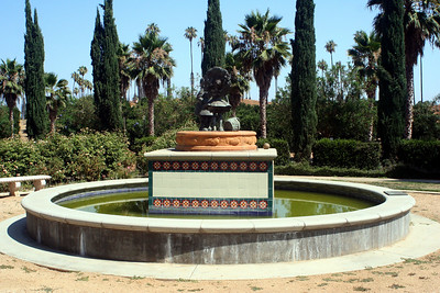 "7/18/09 Fountain/Focal Garden, with statue of a 1908 Sunkist ad of a California girl giving an orange to an Iowa boy (""Miss California and Iowa Boy"").   California Citrus State Park, Riverside, CA"