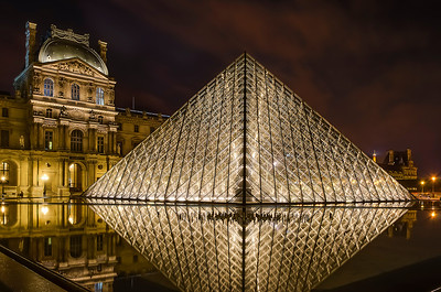 ump to: navigation, search  The Louvre Pyramid (Pyramide du Louvre) is a large glass and metal pyramid, surrounded by three smaller pyramids, in the main courtyard (Cour Napoléon) of the Louvre Palace (Palais du Louvre) in Paris. The large pyramid serves as the main entrance to the Louvre Museum. Completed in 1989 it has become a landmark of the city of Paris.  Commissioned by the President of France François Mitterrand in 1984, it was designed by the architect I. M. Pei, who is responsible for the design of the Miho Museum in Japan and MasterCard Corporate Office Building in Purchase, New York, and Rock and Roll Hall of Fame Museum in Cleveland, and the National Gallery of Art (East Building) in Washington, D.C. among others. The structure, which was constructed entirely with glass segments, reaches a height of 20.6 metres (about 70 feet); its square base has sides of 35 metres (115 ft). It consists of 603 rhombus-shaped and 70 triangular glass segments. The rigging holding the pyramid together was built by Navtec Rod Rigging of Littleton, MA under the direction of Ken King and his partner Mr. Eliason and the experienced design team of Navtec Rod Rigging. In 1989 TriPyramid Structures was formed to use Navtec Rod Rigging in architectural design and building.   The pyramid structure was engineered by Nicolet Chartrand Knoll Ltd. of Montreal (Pyramid structure / Design Consultant) and Rice Francis Ritchie (also known as RFR) of Paris (Pyramid Structure / Construction Phase).