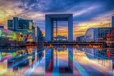 La Grande Arche de la Défense (pronounced: [la ɡʁɑ̃d aʁʃ də la defɑ̃s]; also La Grande Arche de la Fraternité) is a monument and building in the business district of La Défense and in the commune of Puteaux, to the west of Paris, France. It is usually known as the Arche de la Défense or simply as La Grande Arche.  The Arche is in the approximate shape of a cube (width: 108m, height: 110m, depth: 112m); it has been suggested that the structure looks like a hypercube (a tesseract) projected onto the three-dimensional world. It has a prestressed concrete frame covered with glass and Carrara marble from Italy and was built by the French civil engineering company Bouygues.     Equipment=Canon T3I Rebel Lens Used=Tamron AF 17-50mm F/2.8 XR Di-II LD SP Aspherical (IF) Zoom Lens Exposures=7 Location=La Defense, France  Workflow= PhotoMatix 4.2 Adobe PhotoShop Cs6(Lightning Adjustments=4.0) Adobe Light room 5  Software, Nik Color Efex=Brilliance/Warmth,Skylight, Tonal Contrast(Colors Only)  Nik Sharpener Pro 3.0