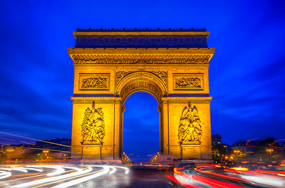 "The Arc de Triomphe de l'Étoile is one of the most famous monuments in Paris. It stands in the centre of the Place Charles de Gaulle (originally named Place de l'Étoile), at the western end of the Champs-Élysées.[3] It should not be confused with a smaller arch, the Arc de Triomphe du Carrousel, which stands west of the Louvre. The Arc de Triomphe (in English: ""Triumphal Arch"") honours those who fought and died for France in the French Revolutionary and the Napoleonic Wars, with the names of all French victories and generals inscribed on its inner and outer surfaces. Beneath its vault lies the Tomb of the Unknown Soldier from World War I.  Equipment=Nikon D7000 Lens Used=Sigma 17-70mm f/2.8-4 DC Macro OS HSM Lens Exposures=7 Location=Paris France  Workflow=PhotoMatix 4.2 Adobe PhotoShop Cs6(Lightning Adjustments=4) Adobe Light room 5   Software, Nik Color Efex=Tonal Contrast"